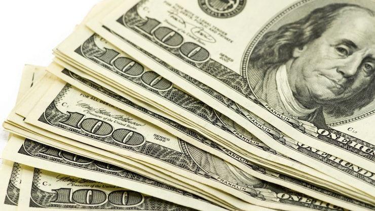 Почему доллар называют баксом, обозначают символом $